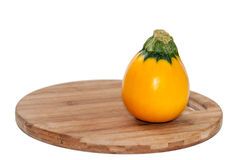 Yellow round zucchini on the kitchen wooden board Stock Photography