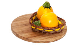 Yellow round zucchini in the wooden basket Stock Photo
