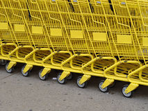 Yellow row. Row of yellow carts Royalty Free Stock Photo