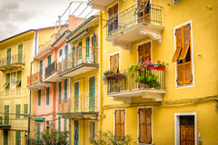 Yellow row houses in the Cinque Terre village of Manarola Italy. On the Mediterranean Sea Royalty Free Stock Image