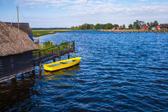 Yellow rowing boat Stock Photos