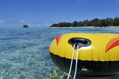 Yellow rubber boat. Little yellow rubber boat in Seychelles lagoon Stock Images
