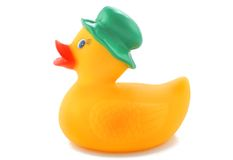 Yellow rubber duck. With a green hat isolated on white stock photos
