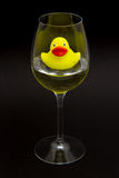 Yellow rubber duck in a wineglass Royalty Free Stock Photos