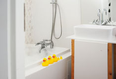 Yellow rubber ducks in the bathroom Royalty Free Stock Image