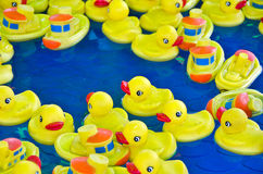 Yellow rubber ducks and boats Royalty Free Stock Images