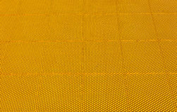 Yellow rubber flooring on Futsal field background Royalty Free Stock Images
