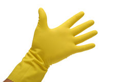 Yellow rubber glove on hand. Photograph of a hand wearing a yellow rubber glove shot in studio and isolated on white Stock Photos