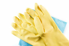 Yellow rubber gloves on blue cleaning napkins. Stock Image