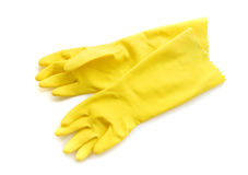 Yellow rubber gloves for cleaning on white background, workhouse. Concept Stock Photos