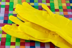 Yellow rubber gloves Stock Images