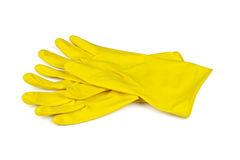 Yellow rubber gloves isolated Royalty Free Stock Photos