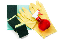 Yellow rubber gloves and scrubber sponges on blue cleaning napki Royalty Free Stock Photo