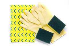 Yellow rubber gloves and scrubber sponges on yellow cleaning nap Royalty Free Stock Photos