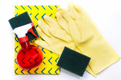 Yellow rubber gloves and scrubber sponges on yellow cleaning nap Stock Photo