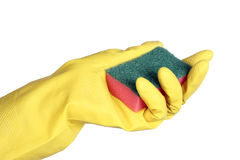 Yellow rubber gloves with sponge Stock Images