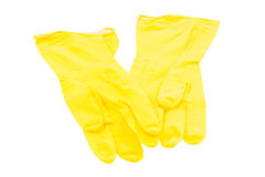 Yellow rubber gloves on a white background Stock Photo