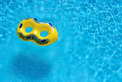 Yellow rubber ring. Floating in swimming pool Royalty Free Stock Photo