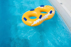 Yellow rubber ring floating Stock Image