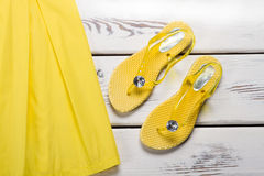 Yellow rubber sandals and dress. Royalty Free Stock Images