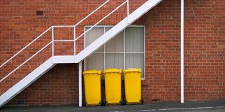 Yellow Rubbish Bins Royalty Free Stock Images