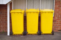 Yellow Rubbish Bins Stock Image