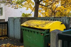 Yellow rubbish container royalty free stock photography