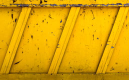 Yellow rubble container. Side details of a yellow  rubble container. Ideas for grunge background Royalty Free Stock Photography