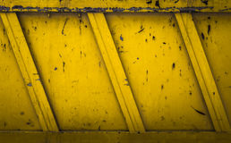 Yellow rubble container. Side details of a yellow  rubble container. Ideas for grunge background Royalty Free Stock Images