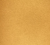 Yellow rugged plaster wall, texture or background Royalty Free Stock Images