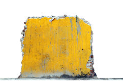 Yellow ruin and rubble. A broken remain of a yellow brick wall isolated against white stock images