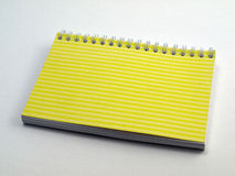 Yellow ruled flip note book 1 Royalty Free Stock Image