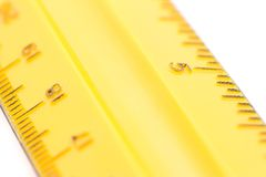 Yellow Ruler. A photo of a yellow ruler isolated over a white background Royalty Free Stock Images