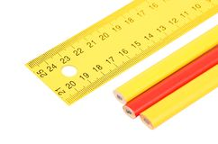 Yellow ruler and pencil Stock Image