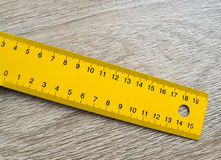 Yellow ruler on the table Royalty Free Stock Images