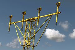 Yellow runway lights. Against a blue cloudy sky Royalty Free Stock Image