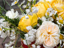Yellow rustic bouquet. Home grown flowers arranged in a tin. Stock Image