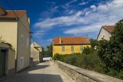Yellow rustic house in Zlarin stock photos