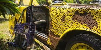 Yellow rusty car Stock Photography