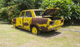Yellow rusty car Stock Photos