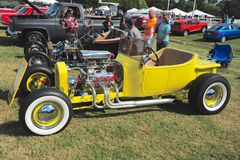 Yellow 1940's Ford T-bucket antique convertible car. Stock Images