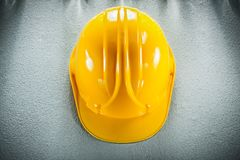 Yellow safety cap on concrete background top view Stock Photography