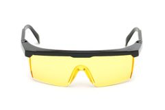 Yellow safety glasses isolated. On the white background Royalty Free Stock Photo