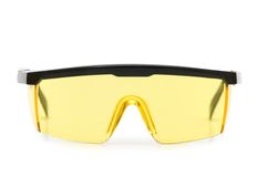 Yellow safety glasses isolated. On the white background Royalty Free Stock Photography