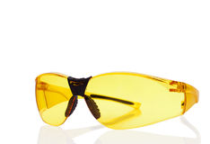 Yellow safety glasses isolated on white. Royalty Free Stock Images