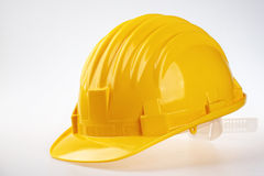 Yellow safety helmet. On white Stock Photos