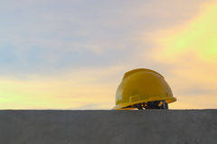 Yellow safety helmet on city sunset background. Yellow safety helmet and  Network control room in background,concept for article Royalty Free Stock Images