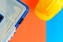 Yellow safety helmet and Construction materials on paper blue an Stock Images