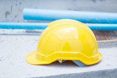Yellow Safety Helmet At Construction Site Stock Photo