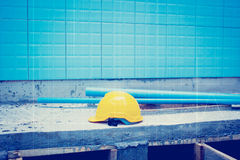 Yellow Safety Helmet At Construction Site Stock Photos
